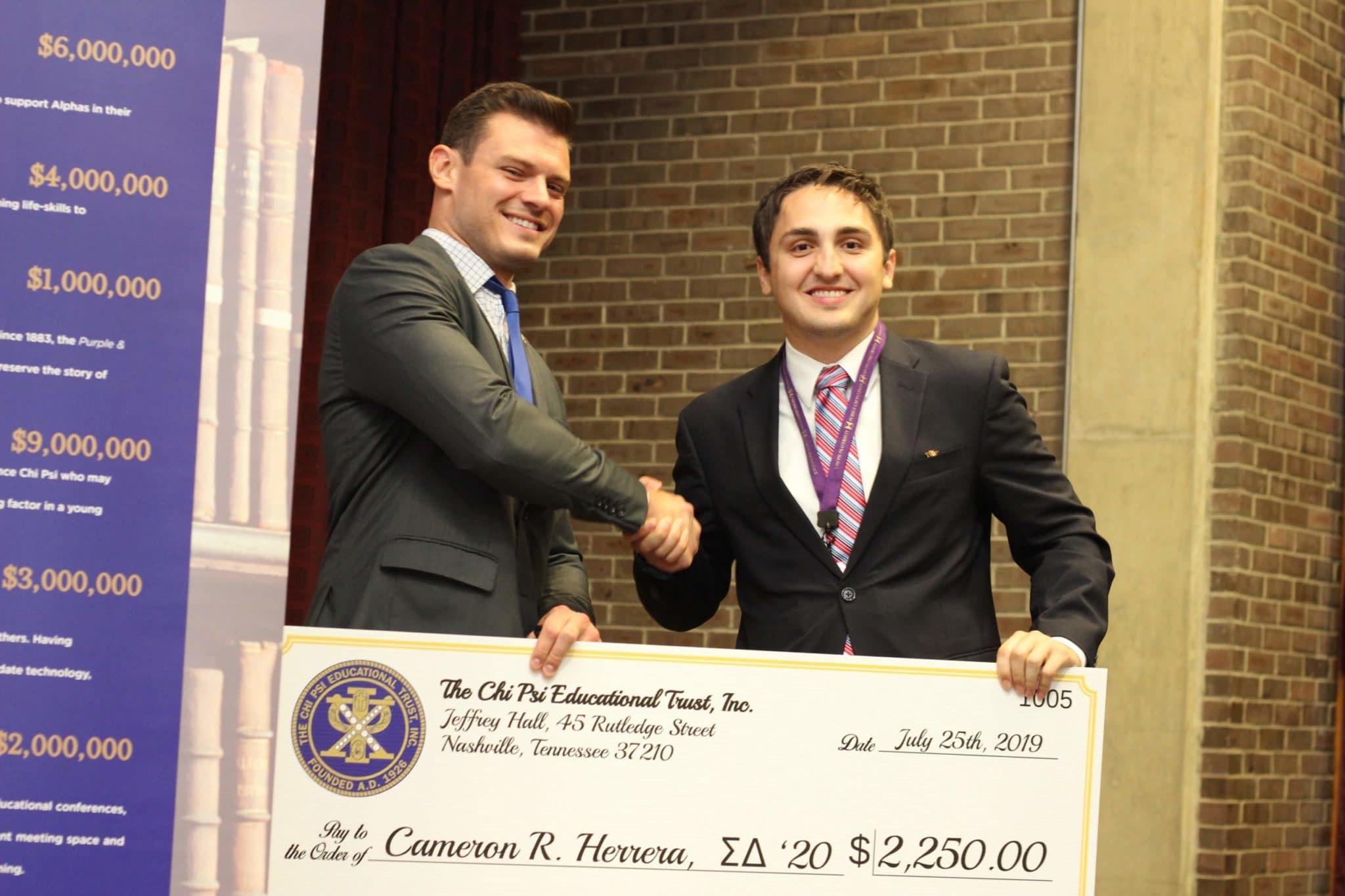 Scholar receiving award for Herrerra Scholarship