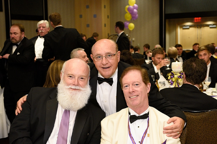 Three Members Sitting at a Convention Table